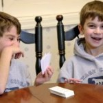 Boys playing math card games
